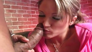 Beautiful lady plays with huge black dick on the couch